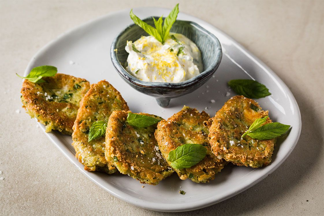 Spicy Pea and Goat's Cheese Fritters with Minted Crème Fraîche