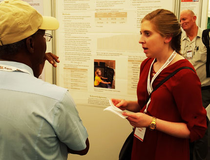 Travel award recipient Courtney Holdt, North Dakota State University, presents her poster. Photo credit Juan Osorno.